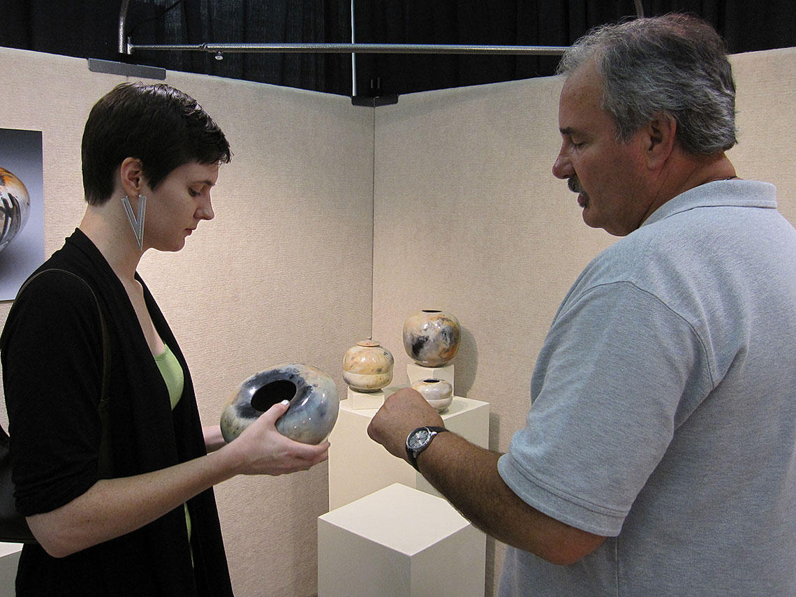 Alex describes his firing technique at the American Craft Exposition, August 2013